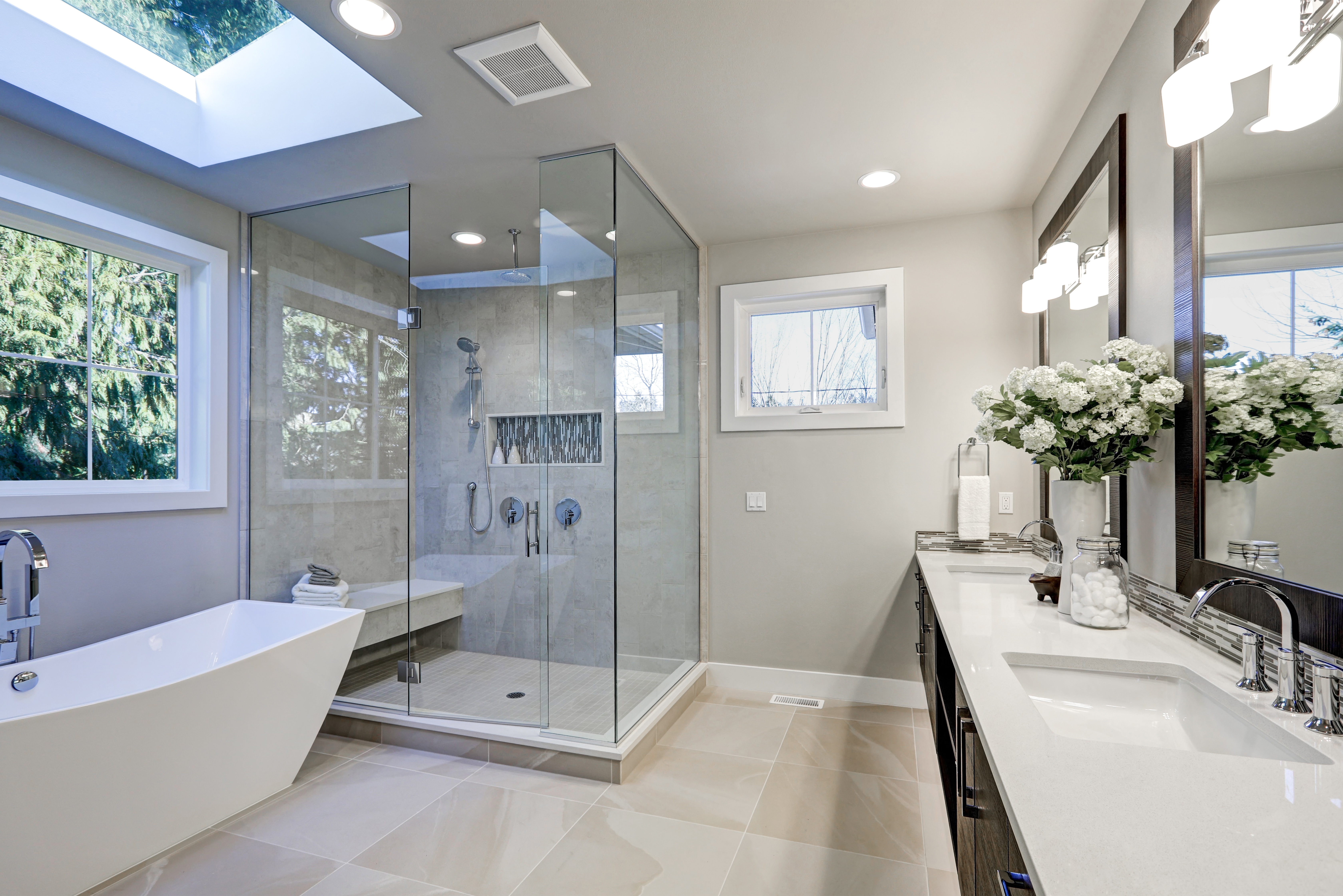 This beautiful bathroom includes a bathroom exhaust fan and windows.
