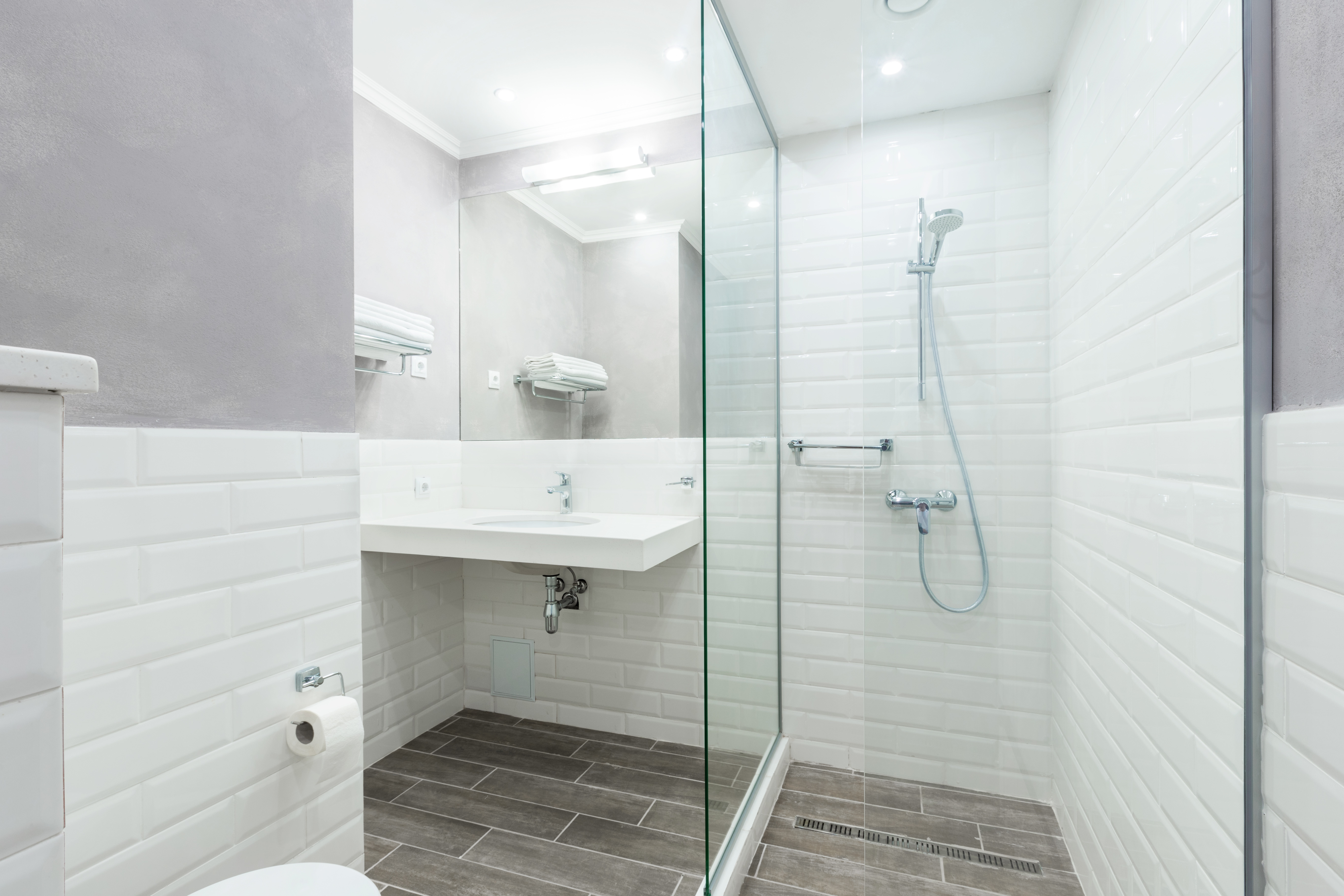 A wet room is ideal if you have a small bathroom or if getting into and out of the bathtub is difficult. It's also a beautiful trend in bathroom designs.