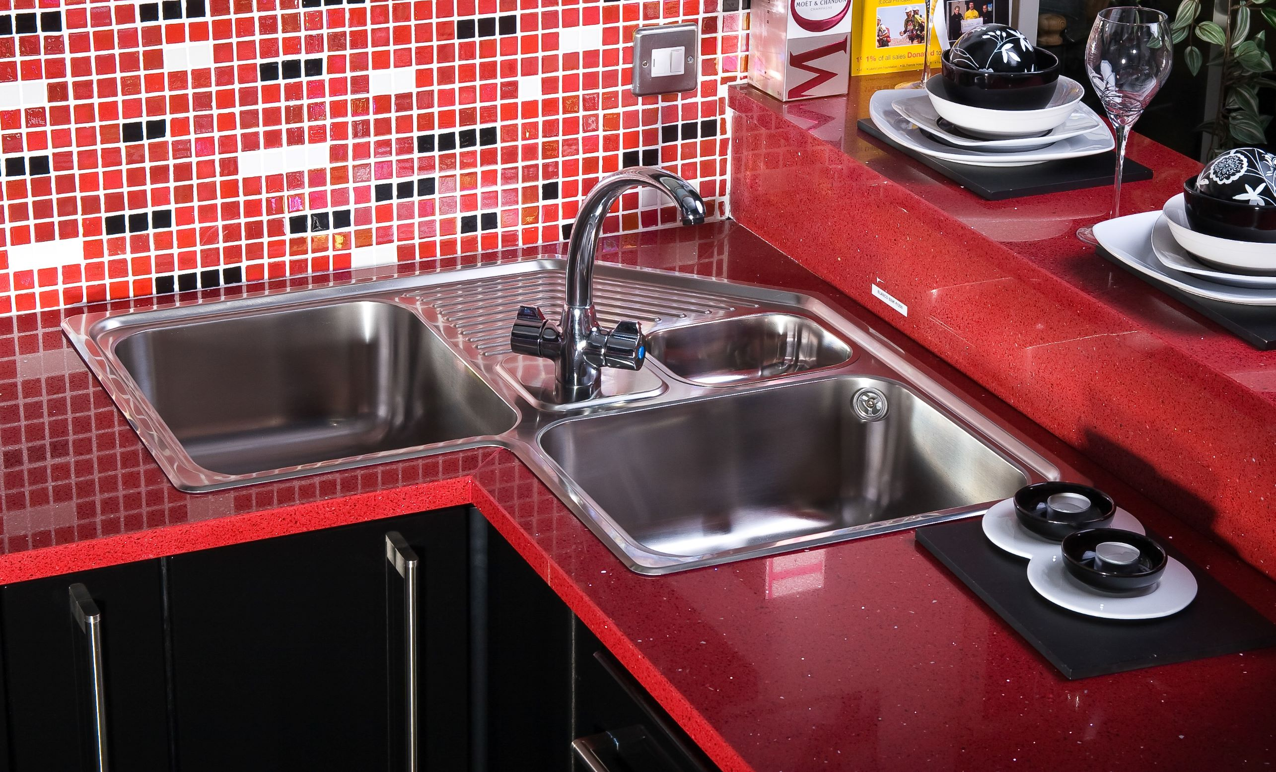 Looking for new kitchen countertop options and design ideas? Red kitchen countertops are certainly different and fun.